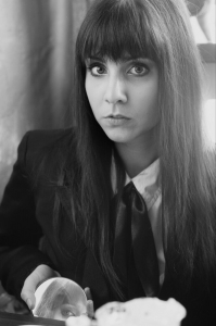 Headshot of poet Andrea Rogers